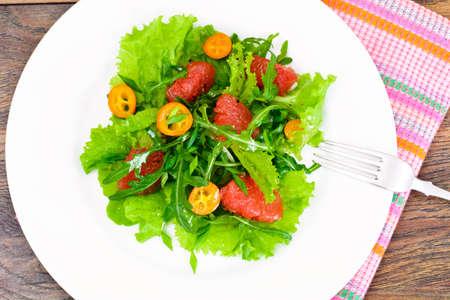 Juicy Fresh Green Salad of Lettuce, Arugula, Gapefruit and Kumquats Studio Photo