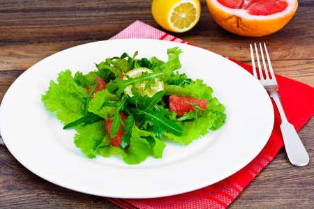 Salad with Mix Batavian, Frise, Radicchio, Chicory, Arugula and Grapefruit Studio Photo Stock Photo
