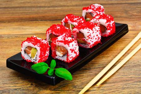 Sushi Florida and California Isolated on Wood Background. Studio Photo