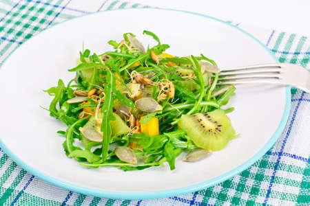 Salad from Grown Wheat, Arugula, Pumpkin Seeds with Sweet Pepper and Kiwi Studio Photo