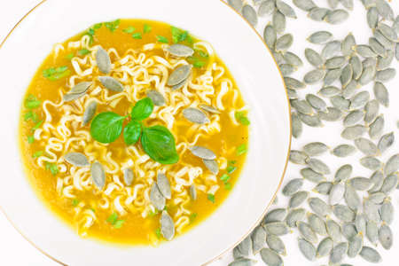 Pumpkin Soup with Pasta and Basil. Diet Food. Studio Photo Stock Photo