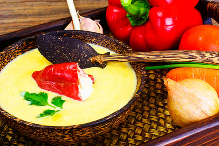 Pumpkin-Potato Puree Cream Soup with Roasted Bell Pepper and Goat Cheese Studio Photo Stock Photo