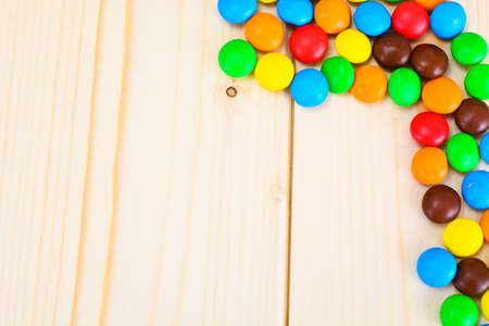 bonbons: Sweet Bonbons Candy on Woody Background