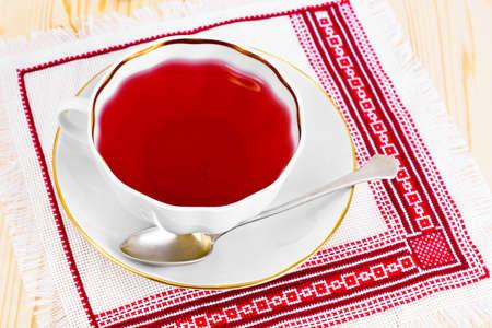 indigenous medicine: Cup of Red Rose Tea Wood Studio Photo Stock Photo