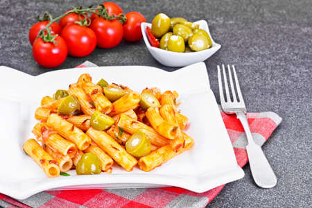 tortellini: Tortellini, Pasna Penne with Ketchup and Green Olives Studio Photo Stock Photo