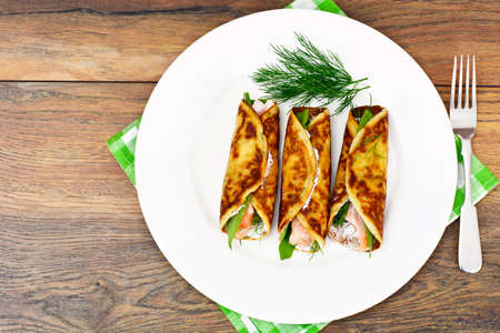 finocchio: Pancake Rolls with Salmon Fried, Goat Cheese, Fennel and Wild Garlic Leaves Studio Photo