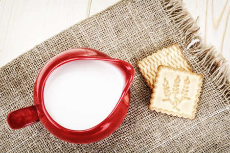 Milk in a Red Earthen Pot Studio Photo Stock Photo