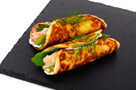 Pancake Rolls with Salmon Fried, Goat Cheese, Fennel and Wild Garlic Leaves Studio Photo