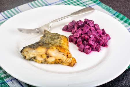 Fried Fish and Salad of Boiled Beets with Yogurt Studio Photo