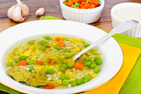 broth: Soup with Chicken Broth with Rice and Vegetables Studio Photo