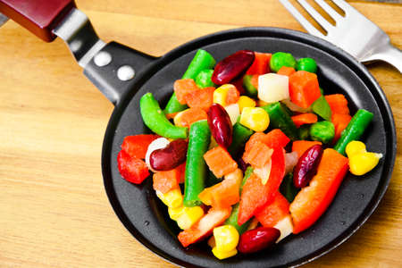 Mexican Mix of Vegetables. Tomatoes, Beans, Celery Root, Green Beans, Peas and Corn Dietary Food Stock Photo