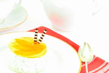 Sweets: Cream Cakes on Plate. Studio Photo