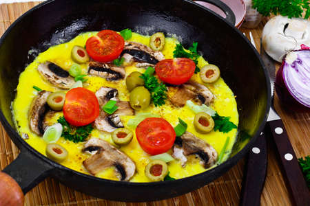 Healthy and Diet Food: Scrambled Eggs with Mushrooms and Vegetables. Studio Photo Reklamní fotografie