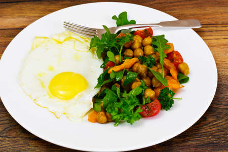 Scrambled Eggs and Salad with Chickpeas and Vegetables Stock Photo