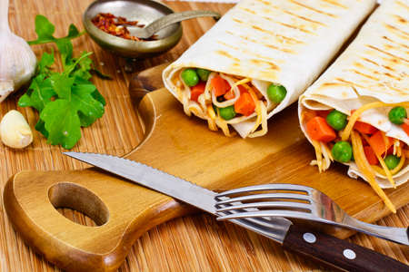 spit: Pita Bread with Vegetables, Chinese Noodles and Arugula Studio Photo Stock Photo