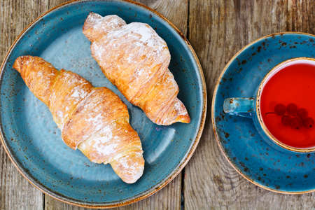 danish puff pastry: Tasty Sweet Croissant on Rustic Wooden Background Studio Photo