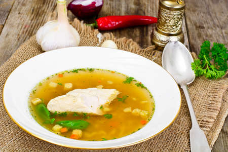 broth: Chicken Broth with Noodles Studio Photo Stock Photo