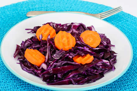 bisected: Salad of Red Cabbage with Vegetable Oil. Diet Food. Studio Photo