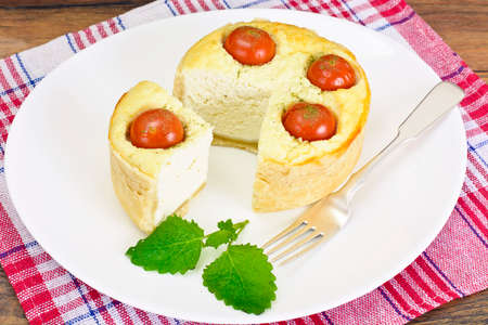 Tasty Baked Pie with Ricotta and Cherry Tomatoes. Studio Photo