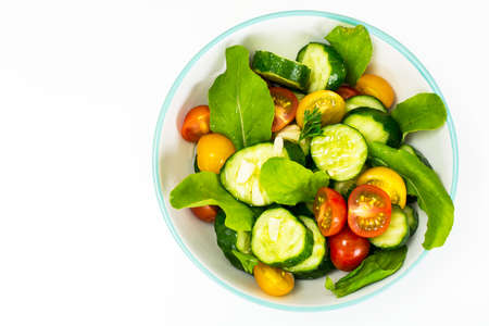 Salad with Arugula, Tomato, Cucumber and Garlic Studio Photo