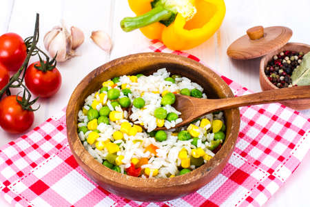Risotto with Vegetables, Corn and Peas. Studio Photo