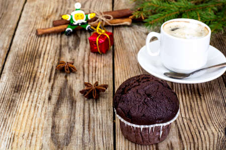 macchiato: Chocolate Muffin with Coffee and Christmas Tree Background Studio Photo