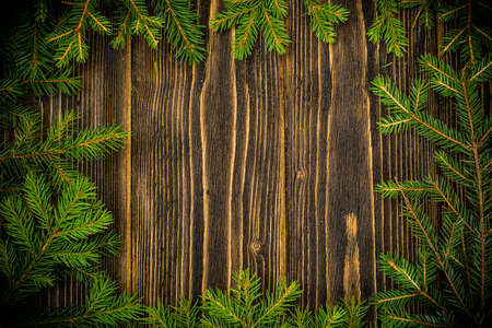 Abstract Christmas and New Year Background with Old Vintage Wooden Boards, Fir Branches Studio Photo