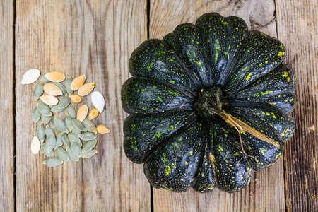 Healthy Food - pumpkin seeds and pumpkin. Studio Photo