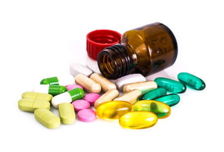 colored bottle: Colored capsules, pills and medical glass bottle. Studio Photo Stock Photo