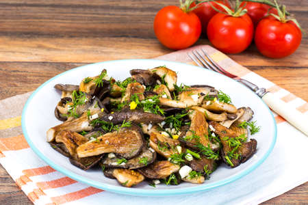 Fried Oyster Mushrooms on White Plate. Studio Photo