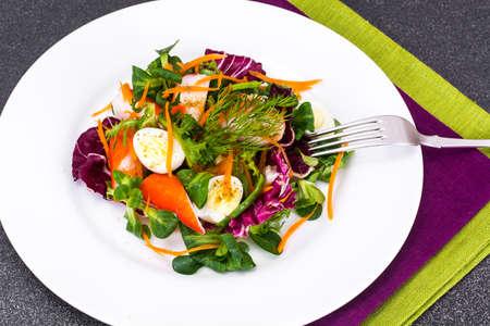 quail: Frise Corn Salad with Chicory, Escarole, Crab Sticks and Quail Eggs Studio Photo