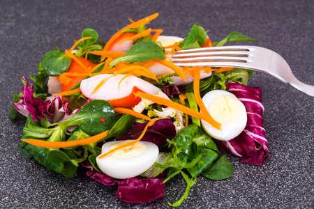 escarola: Frise Corn Salad with Chicory, Escarole, Crab Sticks and Quail Eggs Studio Photo