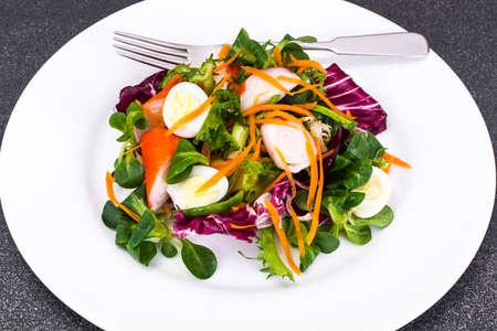 Frise Corn Salad with Chicory, Escarole, Crab Sticks and Quail Eggs Studio Photo