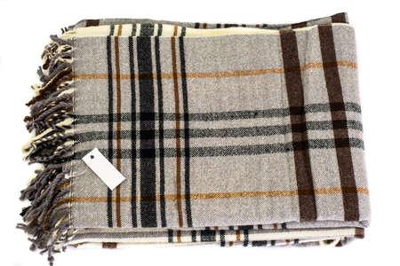 Plaid checkered wool on a white background. Studio Photo