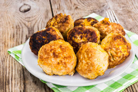 cutlets: Healthy and Diet Food: Chicken Cutlets with Pumpkin. Studio Photo Stock Photo