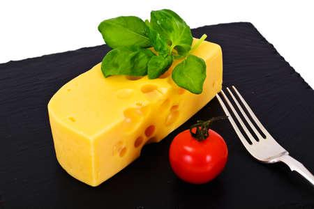 Swiss Cheese on Black Background Studio Photo