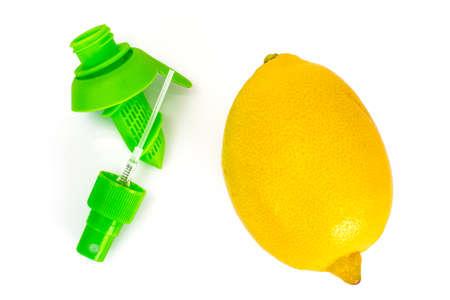 perfumery concept: Citrus juice sprayer and lemon. Studio Photo Stock Photo