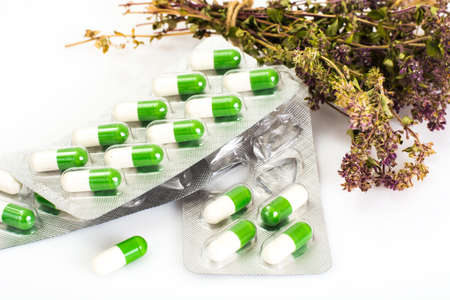 herbology: Medical Herbal capsules are packaged in blisters. Studio Photo Stock Photo