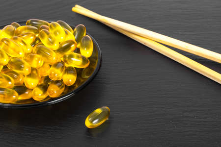 Fish oil supplements in soft gel capsule, healthy product concept. Studio Photo