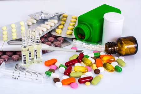 Medical ampules, bottles, pills and syringes, isolated on white. Studio Photo