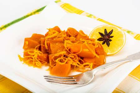Caramel dessert of pumpkin with orange zest. Studio Photo