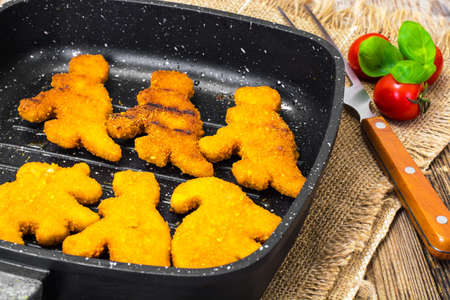 Fish nuggets for kids  Dinosaurs. Studio Photo Фото со стока