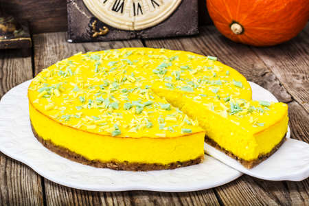 A popular dessert-homemade pumpkin cheesecake on wooden background.Studuo Photo Stock Photo
