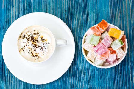 gelatina: Eastern dessert Turkish delight and coffee with cream. Studio Photo