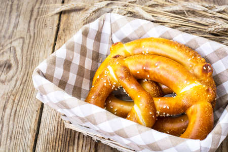 breadbasket: Breadbasket with traditional homemade Bavarian pretzels. Studio Photo