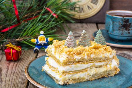 Napoleon cake for Christmas and New Year. Studio Photo