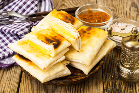 Fried pita bread with cheese