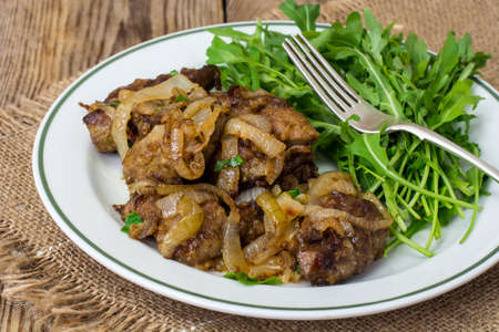 Calfs liver with arugula garnish Stock Photo