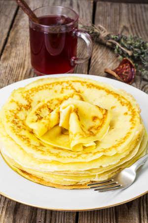 Pancakes and fruit tea with cinnamon