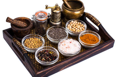 Set of spices and seeds of legumes in glass molds on tray